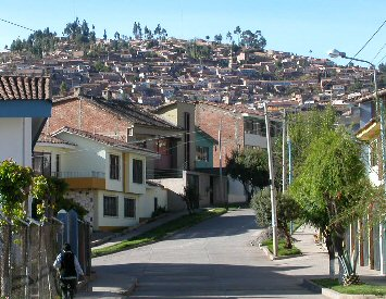 Houses march up the hillside