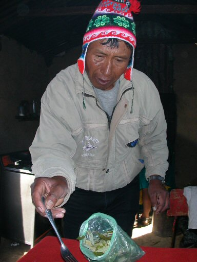 Juan Quispe makes breakfast in Amantani